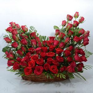 Vibrant Red Roses in an Oval Shaped Basket